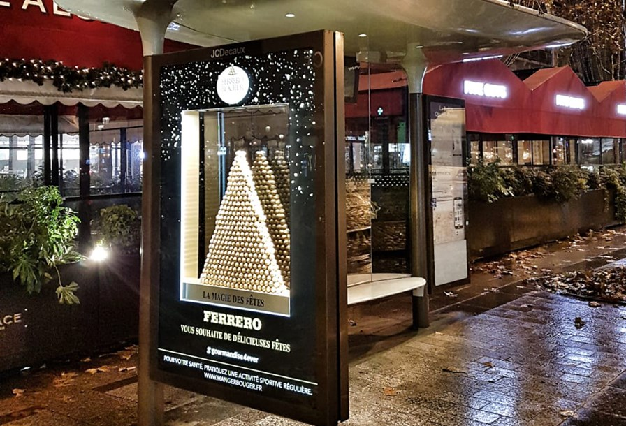 JCDecaux France | Bus Shelter Special Build | Ferrero | Ferrero transformed two passenger shelters in Paris, lighting up the streets with a rear window covering to festively showcase it's Nutella and Ferrero Rocher range.